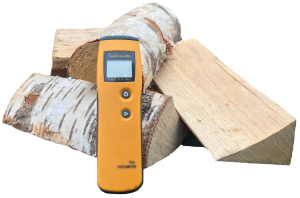 Photo of moisture meter with birch logs